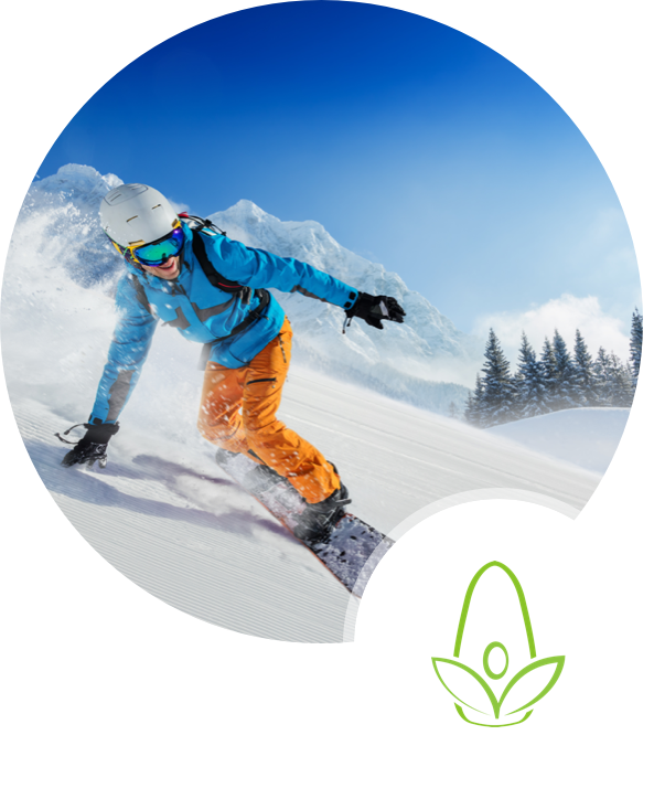 man snowboarding on hill