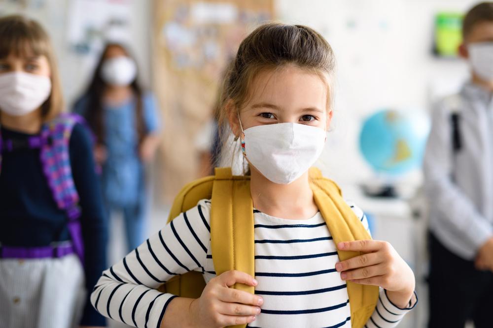 girl at school wearing mask