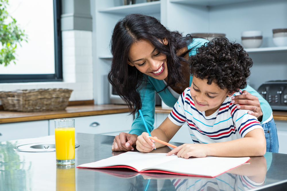 mother helping son with learning challenges