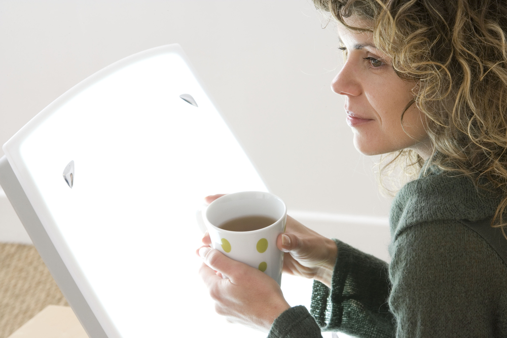 woman with seasonal affective disorder uses light therapy