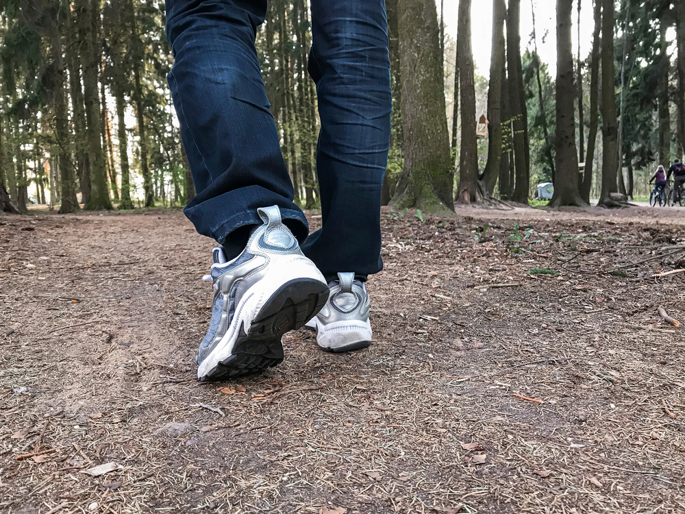 person with depression walks in woods