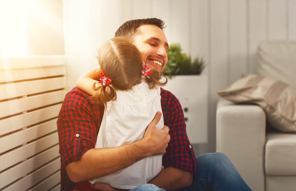 parent hugs autistic child